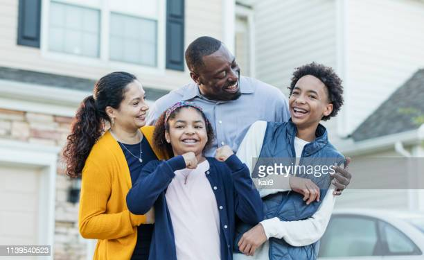 mixed race african-american and hispanic family - brace stock pictures, royalty-free photos & images
