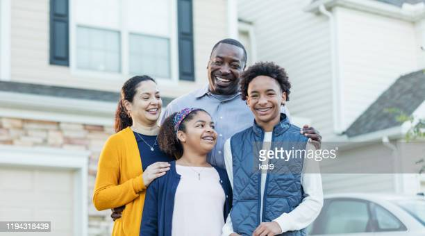 mixed race african-american and hispanic family - in front of stock pictures, royalty-free photos & images
