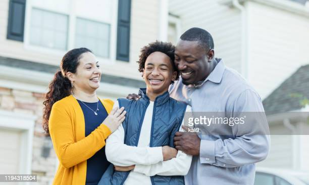 mixed race african-american and hispanic family - teenager stock pictures, royalty-free photos & images