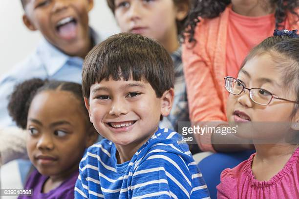 Mixed race Asian boy with elementary school class
