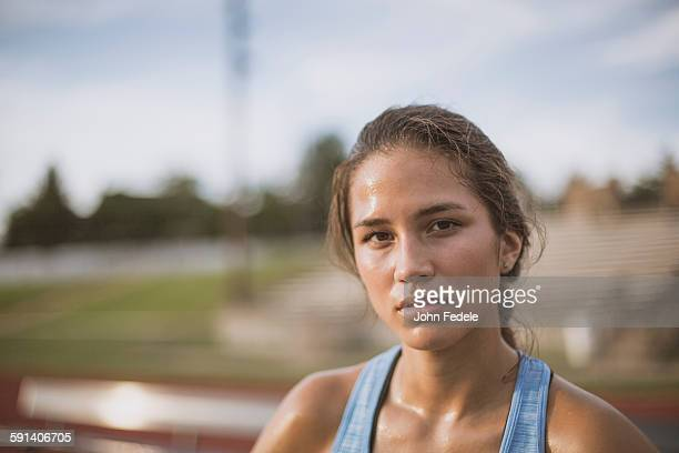Mixed race athlete on sports field