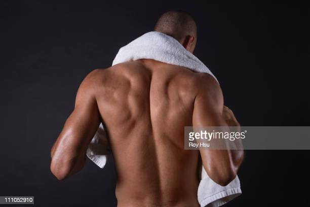 Mixed race athlete standing with towel around neck