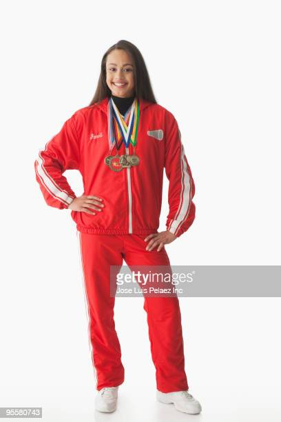 Mixed race athlete wearing medals