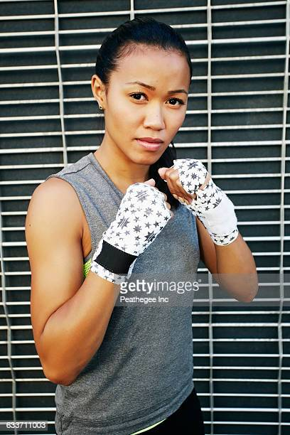 Mixed race athlete with raised fists
