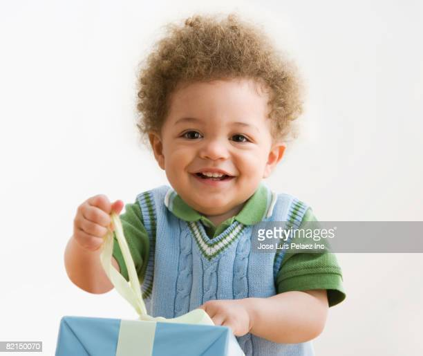 Mixed Race baby opening gift