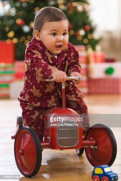 Mixed race baby riding on old-fashioned truck