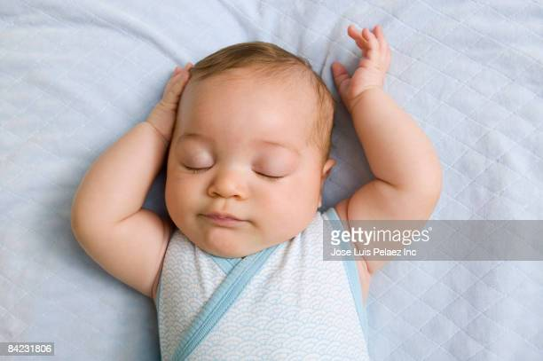 mixed race baby sleeping - one baby boy only stock pictures, royalty-free photos & images