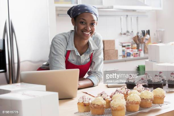 Mixed race baker smiling in commercial kitchen