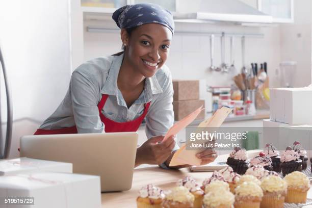 Mixed race baker working in commercial kitchen