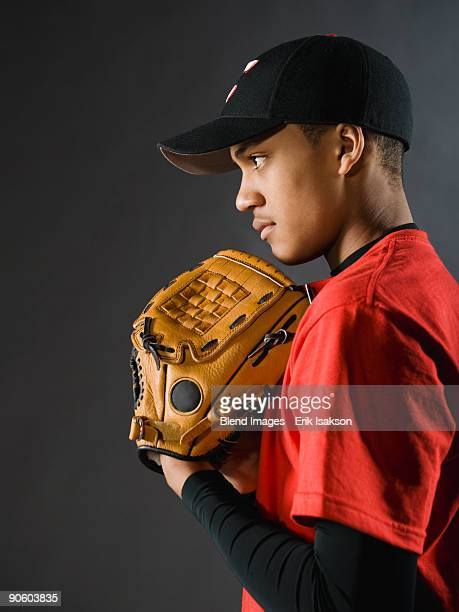 mixed race baseball player looking serious - baseball pitcher stock pictures, royalty-free photos & images