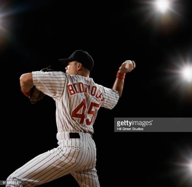 mixed race baseball player pitching - baseball pitcher stock-fotos und bilder