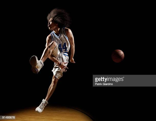 mixed race basketball player passing basketball - passing sport stock pictures, royalty-free photos & images
