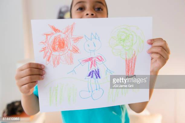 Mixed race boy displaying drawing
