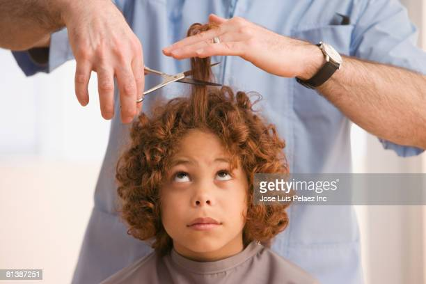 mixed race boy getting haircut - stubborn stock pictures, royalty-free photos & images