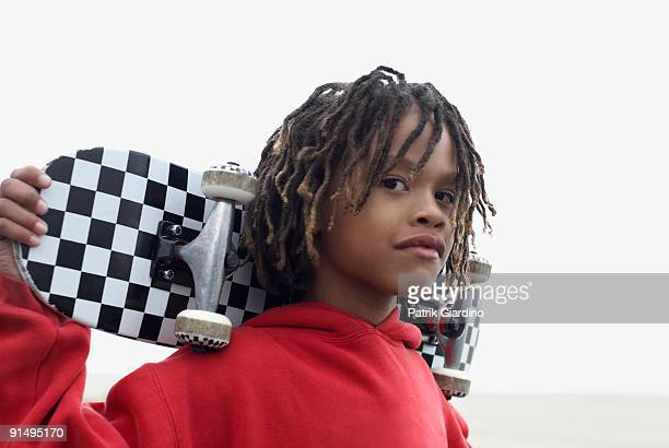mixed race boy holding skateboard - dreadlocks stock pictures, royalty-free photos & images