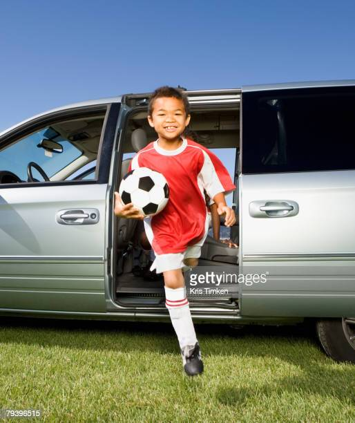 mixed race boy holding soccer ball - football strip stock pictures, royalty-free photos & images