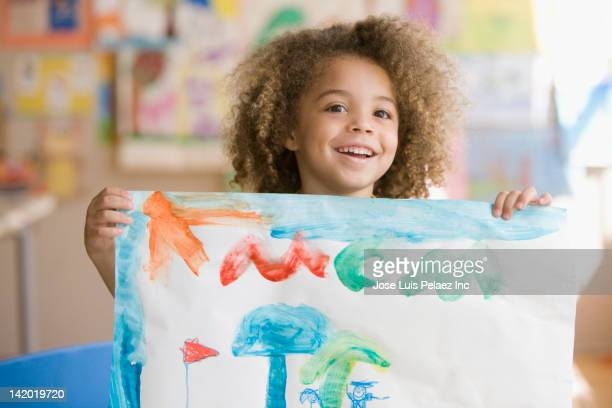 mixed race boy holding up picture - art and craft stock pictures, royalty-free photos & images