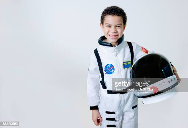 mixed race boy in astronaut costume - space helmet stock photos and pictures