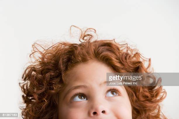 mixed race boy looking up - curiosity stock photos and pictures