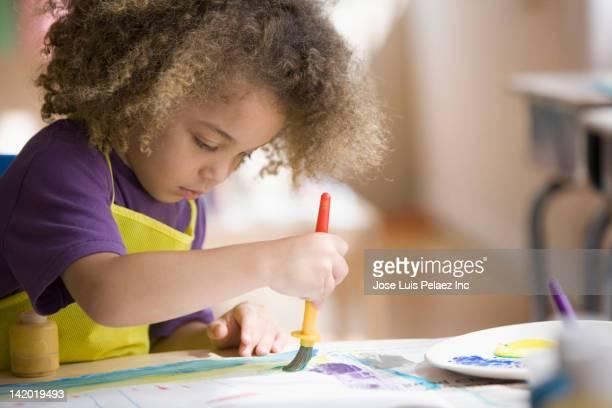 mixed race boy painting picture - arte y artesanía fotografías e imágenes de stock