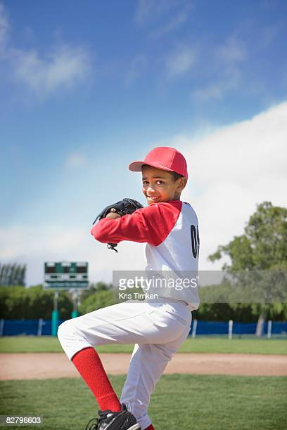 mixed race boy pitching in baseball game - 投手 ストックフォトと画像