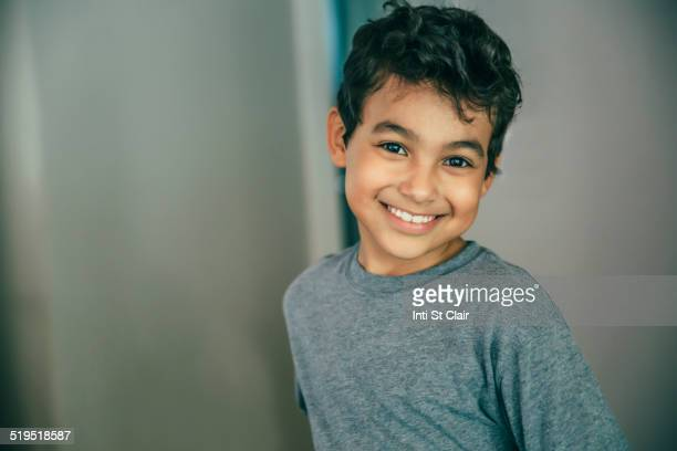 Mixed race boy smiling