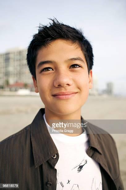 Mixed race boy smiling