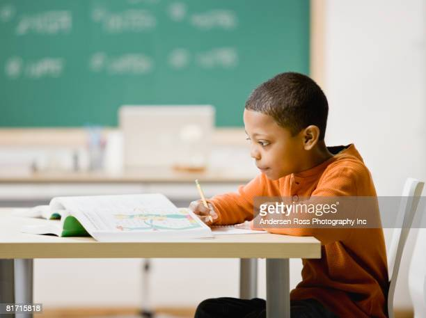 Mixed Race boy studying