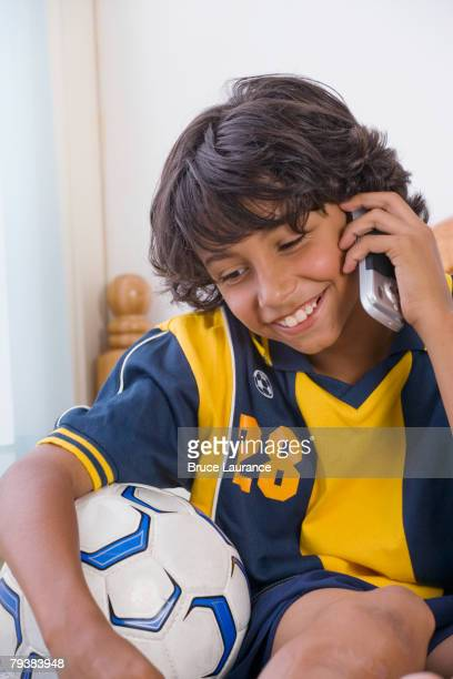 Mixed Race boy talking on cell phone