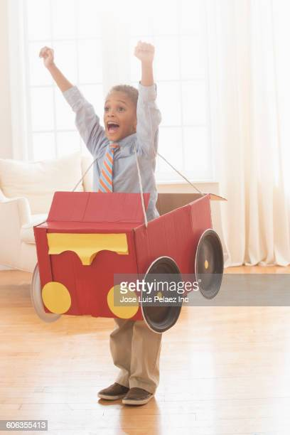 Mixed race boy wearing car costume