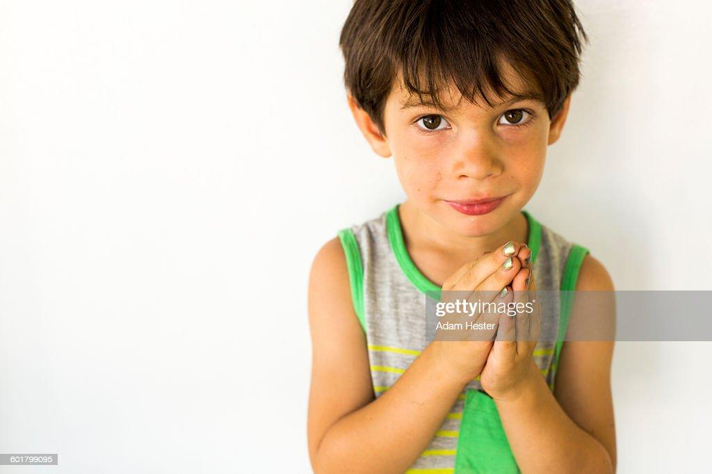 Mixed race boy wearing nail polish : Stock Photo
