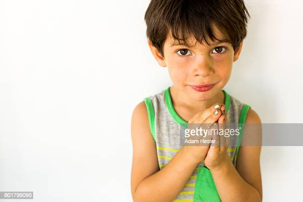 Mixed race boy wearing nail polish