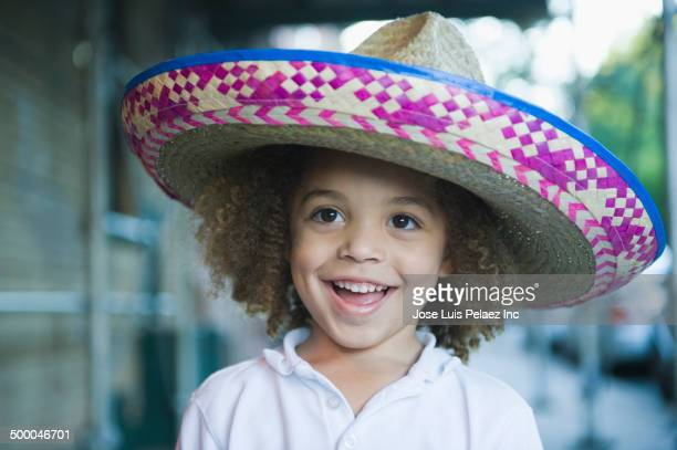 mixed race boy wearing sombrero - mexican hat stock pictures, royalty-free photos & images