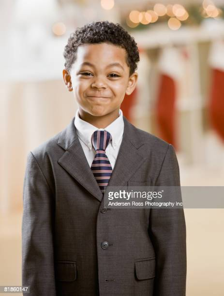 Mixed Race boy wearing suit