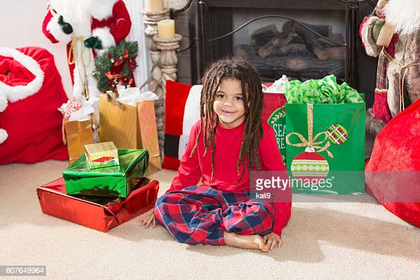 Mixed race boy with dreadlocks at Christmas