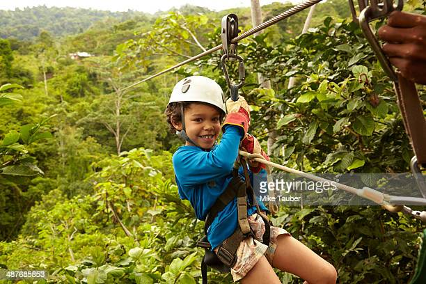 Mixed race boy zip lining