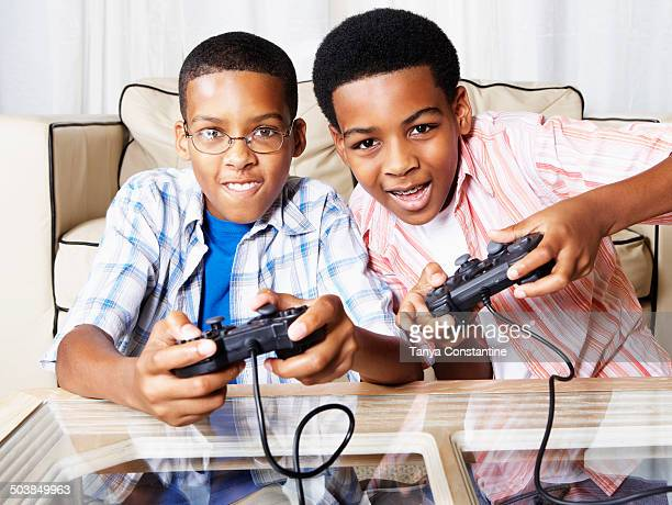 Mixed race boys playing video games