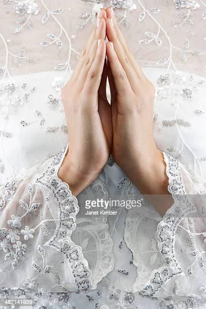 Mixed race bride's hands in prayer position