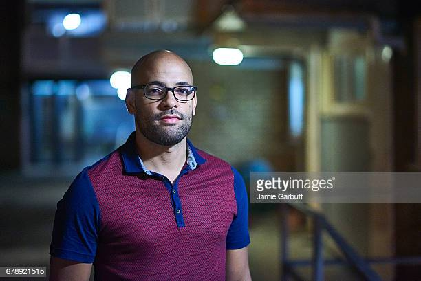 mixed race british male stood outside his flat - railings stock pictures, royalty-free photos & images
