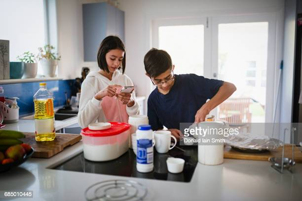 Mixed Race brother and sister baking in kitchen