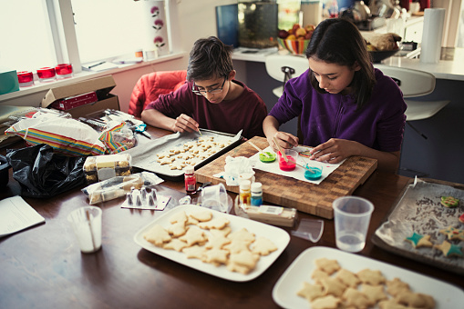 Mixed race brother and sister decorating cookies - gettyimageskorea