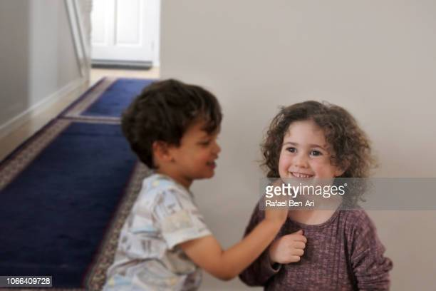 Mixed Race Brother and Sister Having Fun Togethe