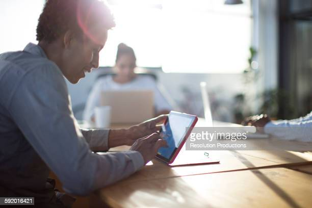 Mixed race business people using technology in office