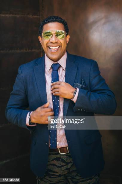 Mixed race businessman adjusting his tie