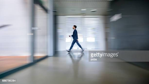 mixed race businessman in busy workplace - incidental people stock pictures, royalty-free photos & images