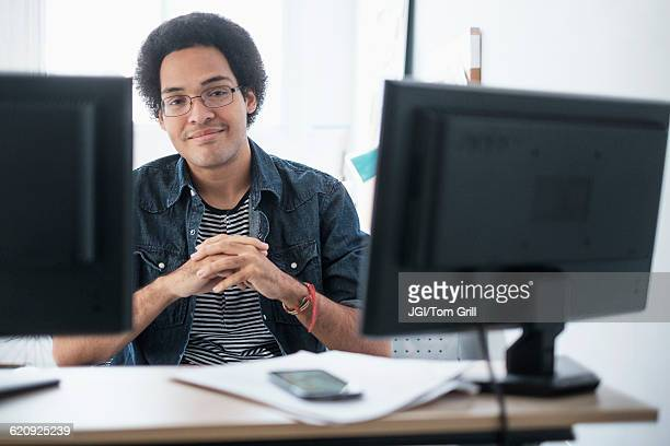 mixed race businessman smiling in office - zakelijke kleding stock pictures, royalty-free photos & images