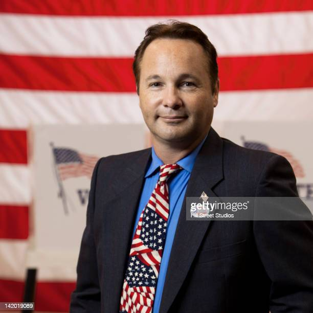 mixed race businessman standing in polling place - gardena california stock pictures, royalty-free photos & images