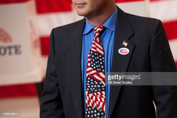 Mixed race businessman standing in polling place