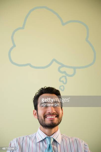Mixed race businessman with thought bubble