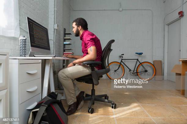 Mixed race businessman working at desk